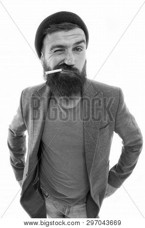 Man Brutal Bearded Hipster Dressed As Vagabond Smoking Cigarette. Brutal Habits And Lifestyle Of Tra