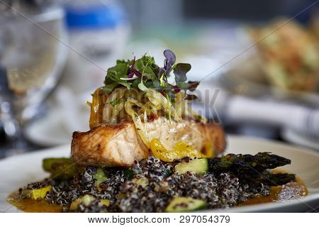 Close Up Of Grilled Salmon Laying On A Bed Of Black Quinoa With Shallow Depth Of Field