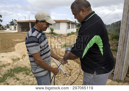Cerro Goldo, Bayamon/puerto Rico - February 22, 2019: Two Men Work On Wiring At A Building Construct