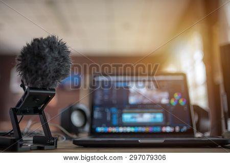 Blurred Laptop Desktop Office Content Creator Or Vlog Editor