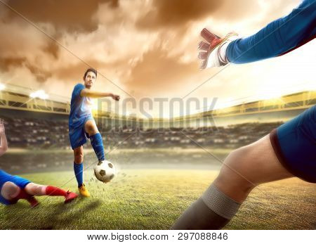 Asian Football Player Man Sliding Tackle The Ball From His Opponent Before Him Kicking The Ball To T