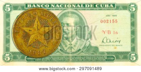1 Cuban Peso Coin Against 5 Cuban Peso Banknote