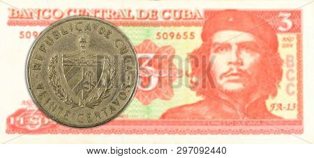 20 Cuban Centavo Coin Against 3 Cuban Peso Banknote