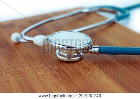 Stethoscope  On A Wood Background, Checkup, Stetoscope, Illness, Diagnosis, Instrument, Health-care,