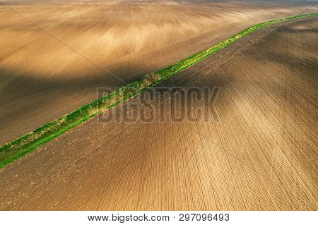 Aerial View Of Dried Irrigation Ditch Canal Through Agricultural Field During Hot Summer Season, Dro