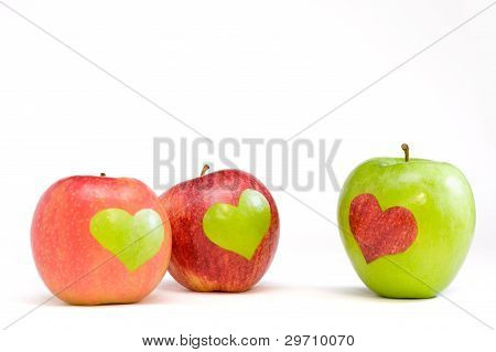 three apples with hearts