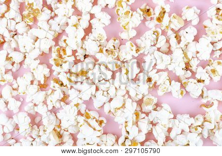 Popcorn Scattered At The Pastel Pink Background And A Space For Copyspace. Popcorn On A Red Backgrou
