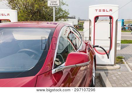 Euro Rastpark Pfaffenhofen, Germany - April 9, 2019 Charging Tesla Cars At The Charging Station. Tes