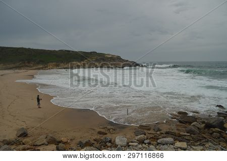 Person Fishing On A Cloudy Day On Big Beach In Colares. Nature, Architecture, History, Street Photog