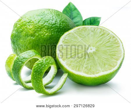 Ripe lime fruits with lime peel and leaves on the white background.
