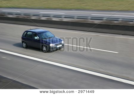 Car In Motion On A German Highway