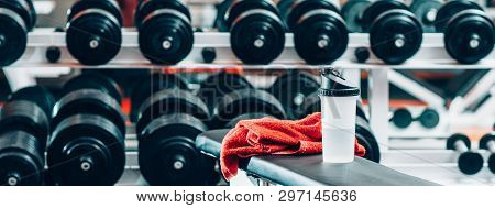 Sport And Recreation. Fitness And Bodybuilding Concept. Weight Training. Closeup Of Towel And Bottle