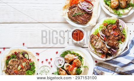 Grilled Meat Meals On Table Flat Lay. Top View On Assortment Of Bbq Snacks. Summer Foods Barbecue Di