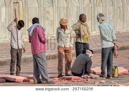 Agra, India - March 5 2018: Workers Working On Reparation Of The Famous Taj Mahal.