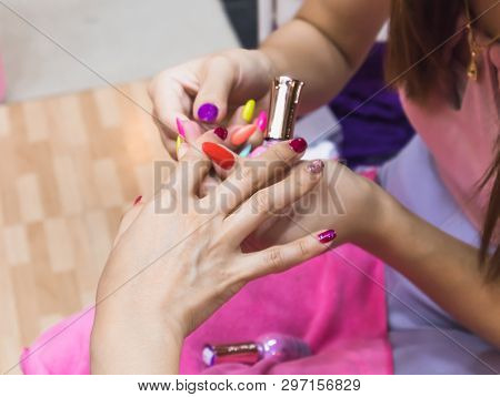 Close Up Of Female Hands Holding Another Hand