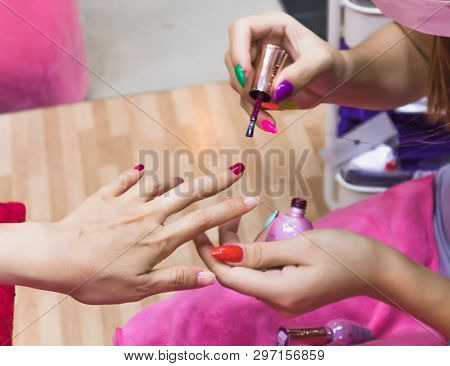 Close Up Of Female Hands In Nail Beauty Salon