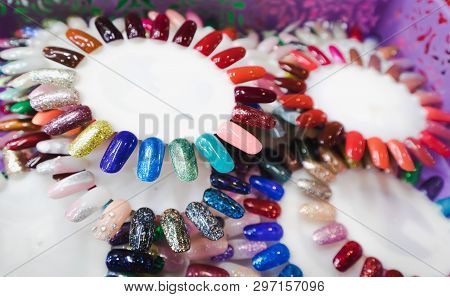 Nail Polish In Different Fashion Color Wheel. Colorful Nail Lacquer Mock-up Example
