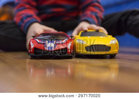 Child Playing With A Wheelchair With A Remote At Home. Radio Controlled Car Toy For Children. Boy Wi