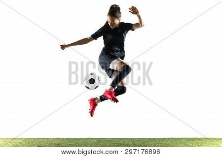 Young Female Soccer Or Football Player With Long Hair In Sportwear And Boots Kicking Ball For The Go