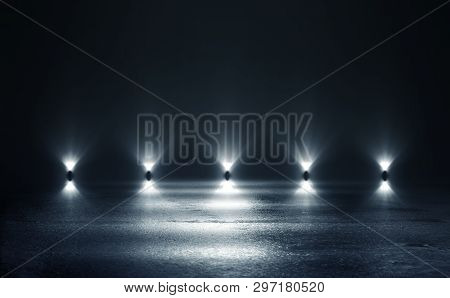Empty Background Scene. Dark Street Reflection On The Wet Pavement. Rays Of Blue Neon Light In The D