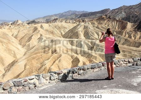 Death Valley, Usa - April 13, 2014: Tourist Takes Mobile Photos Of Zabriskie Point In Death Valley,