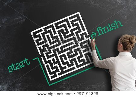 Finding Creative And Smart Solutions Concept With Woman Bypassing Labyrinth By Drawing Line Around I