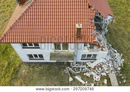 Aerial View On Damaged Red Single House Roof After Strong Wind Or Explosion. Hole In The Rooftop And