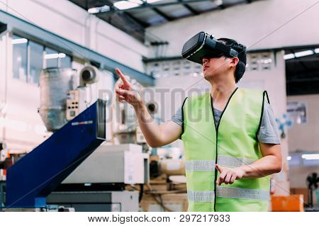 Industrial Factory And Manfacturing Engieering Worker Wearing Vr Goggle Headset Touching In Virtual