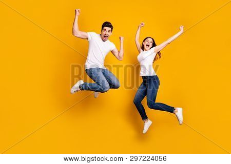 Full Length Body Size Photo Funky She Her He Him His Pair Jumping High Raised Fists Yell Scream Shou