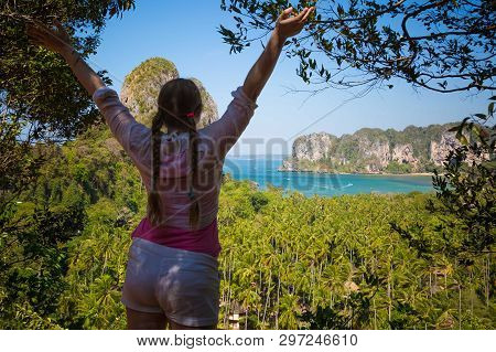 View On Two Sides Of Railay And Tonsai Beach. Blurred Woman At Foreground With Hair Braids In Pink S