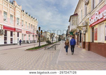Feodosia, Crimea, Russia - March 08, 2019: People On The Pedestrian Street Zemskaya. Spring Day In T