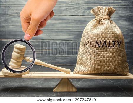 Bag With The Word Penalty And Gavel On The Scales. Penalty As A Punishment For A Crime And Offense.