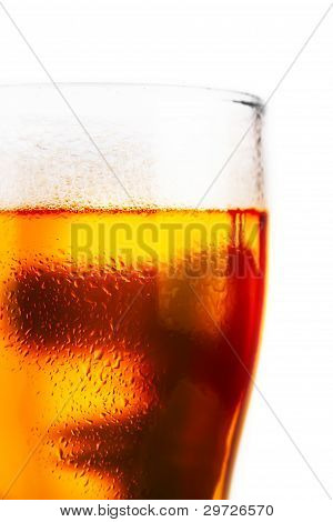 Cold Glass Of Beer With Foam