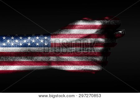A Hand With A Painted Usa Flag Shows A Barreling, A Sign Of Aggression, Disagreement, A Dispute On A