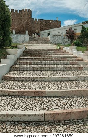 Cobblestone Stairway Up The Hill Towards The Gothic Castle, In A Cloudy Day At Estremoz. A Nice Litt
