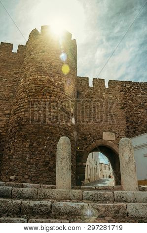 Gothic Door In The Stone Outer Wall Called Sun Gateway, On Sunshine At The Castle Of Estremoz. A Nic