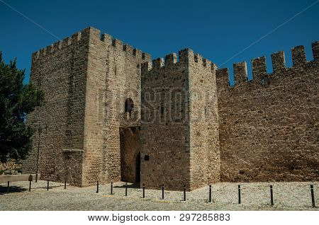 Stone Walls And Towers With Merlons On A Sunny Day, In The Front Facade Of The Elvas Castle. A Graci