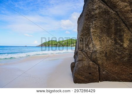 Huge Rock On Seychelles Sand Beach Day