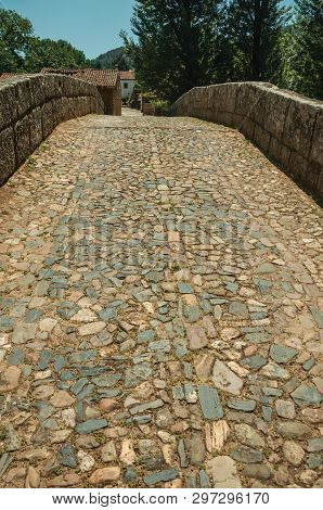 Cobblestone Pavement And Breastwork Over An Old Roman Bridge Still In Use Over The Sever River Among