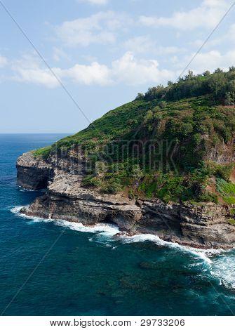 Cliffs housing bird sanctuary at Kilauea on north shore of Kauai poster