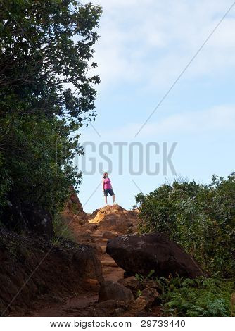 Girl Hiking Kalalau Trail In Kauai