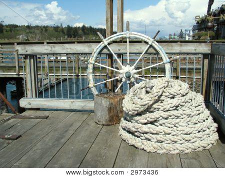 Nautical Theme Of Ship Wheel And Rope