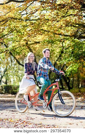 Young Tourist Pair, Handsome Bearded Man And Attractive Blond Long-haired Woman Cycling Together Tan
