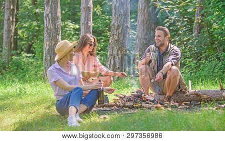 Spend Great Time On Weekend. Company Hikers At Picnic Roasting Marshmallows Snacks Eating Food. Take