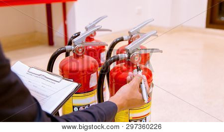 Red Tank Of Fire Extinguisher. Overview Of A Powerful Industrial Fire Extinguishing System.
