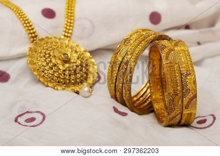 Close-up Of Artificial Golden Bangles And Necklace