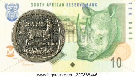 1 Rand Coin Against 10 South African Rand Bank Note Obverse