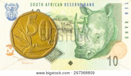 50 South African Aforika Coin Against 10 South African Rand Banknote
