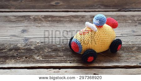 Colored Crochet Racing Car. Toy For Babies And Toddlers To Learn Mechanical Skills And Colors. Handm