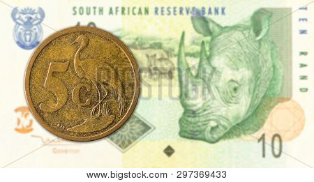 5 South African Aforika Coin Against 10 South African Rand Banknote